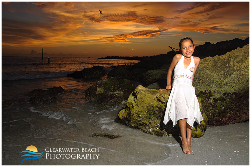 Young girl by rocks on Clearwater Beach