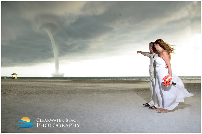 Couple pointing at water spout off of Clearwater Beach