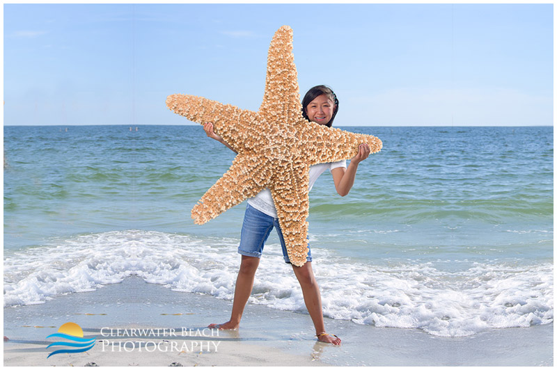 Girl holding giant star fish on Clearwater Beach