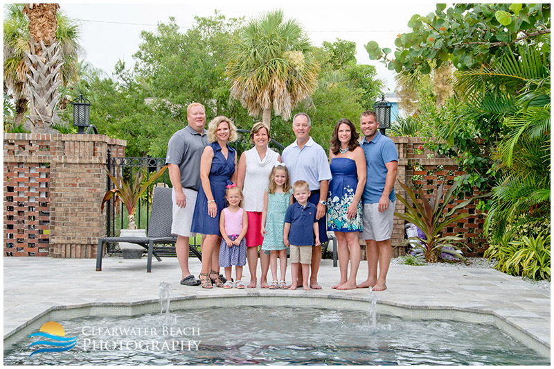 Family by pool in Clearwater Beach House