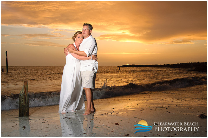 Couple in front of storm clouds on Clearwater Beach