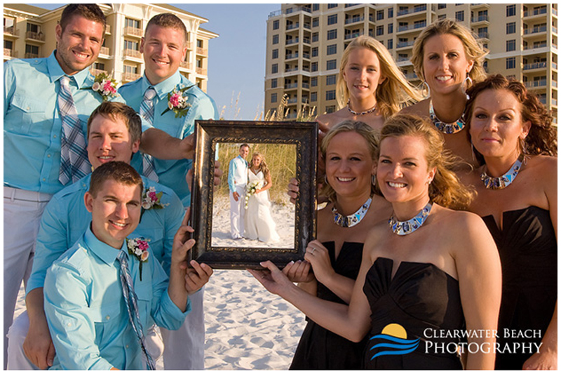Clearwater Beach Wedding Portrait of Bridal Party holding Frame